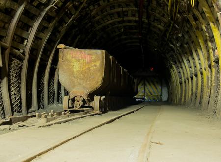 exploit: Ruda Slaska, Poland - November 05, 2015:  Coal mine. A cart full of coal  in a mine tunnel