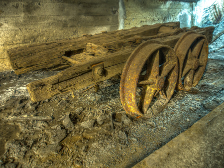 coal truck: Coal mine. Old rusty truck in a tunnel of a mine.