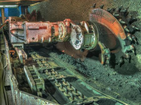 Ruda Slaska, Poland - November 05, 2015: A shearer l machine working  in a coal mine. Banco de Imagens