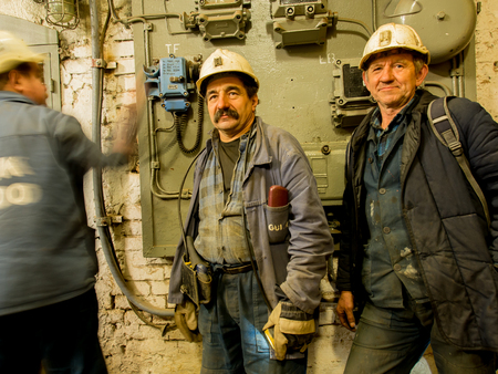 boiler suit: Ruda Slaska, Poland - November 05, 2015:  Employees of a coal mine wearing working clothes and waiting for an elevator.