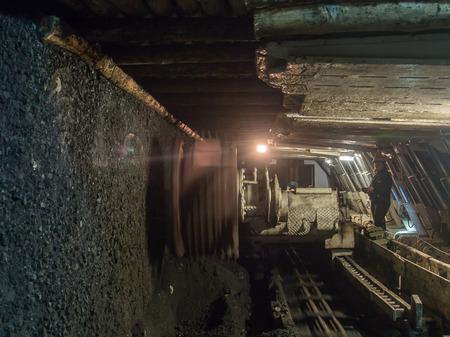 Ruda Slaska, Poland - November 05, 2015: A shearer l machine working  in a coal mine. Editorial