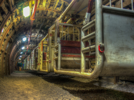 stanchion: Ruda Slaska, Poland - November 05, 2015: Moving carts to transport people in a coal mine tunnel