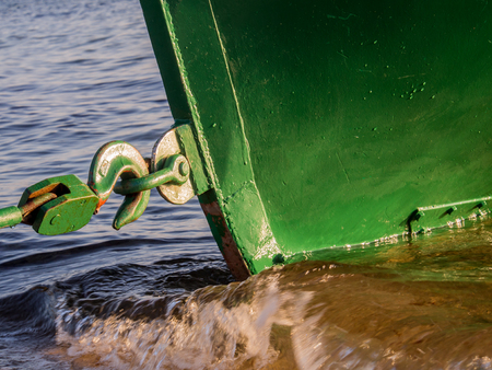 gaff: The steel hook retainer boat moored to the shore Stock Photo