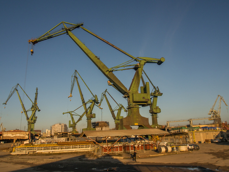 shipbuilder: Gdask, Poland - September 27, 2015: Huge harbor cranes in the port of Gdask