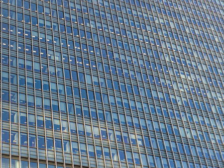 agglomeration: A huge number of windows in a glass office building