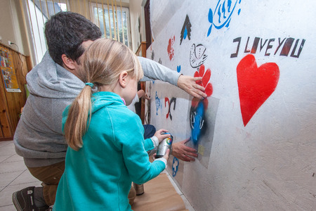 providing: Jozefow, Poland - October 24, 2015: A teacher of painting providing guidance to a schoolgirl Editorial