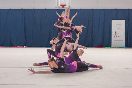 aesthetical: Warsaw,  Poland -  June 25,  2016:  The competition of art gymnastics. A group of girls begin their art gymnastics performance