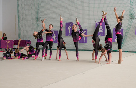 Warsaw,  Poland -  June 25,  2016:  The competition of art gymnastics. A group of girls begin their art gymnastics performance