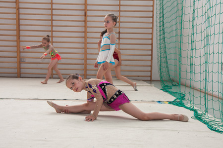 aesthetical: Warsaw,  Poland -  June 25,  2016:  The competition of art gymnastics. A group of small girls practicing before the competition