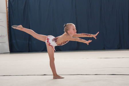 deftness: Warsaw,  Poland -  June 25,  2016:  The competition of art gymnastics. Young gymnast during her performance Editorial