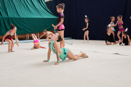 Warsaw,  Poland -  June 25,  2016:  The competition of art gymnastics. A group of small girls practicing before the competition