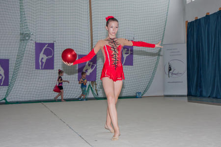 aesthetical: Warsaw,  Poland -  June 25,  2016:  The competition of art gymnastics. Young gymnast is with a ball