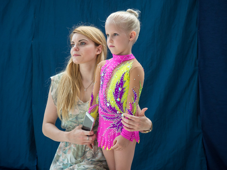 aesthetical: Warsaw,  Poland -  June 25,  2016:  The competition of art gymnastics. A coach provides the last minute tips and hints before the gymnastics show