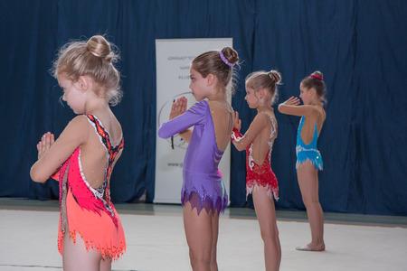 deftness: Warsaw,  Poland -  June 25,  2016:  The competition of art gymnastics. A group of girls begin their art gymnastics performance