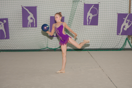 Warsaw,  Poland -  June 25,  2016:  The competition of art gymnastics. Young gymnast is with a ball