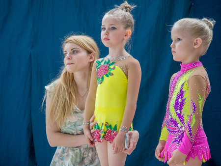 deftness: Warsaw,  Poland -  June 25,  2016:  The competition of art gymnastics. A coach provides the last minute tips and hints before the gymnastics show