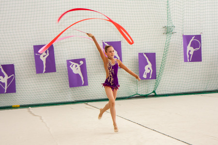 Warsaw,  Poland -  June 25,  2016:  The competition of art gymnastics. A gymnast with the sash
