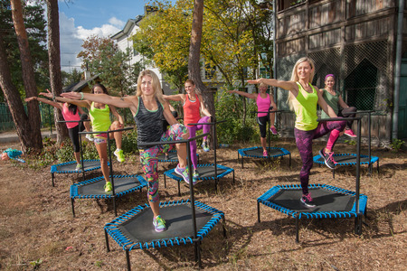 Otwock, Poland - Septemberr 25, 2016:  Fitness women jumping on small trampolines