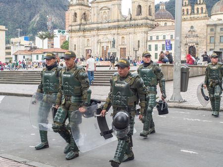 be alert: Bogota, Colombia - May 01, 2016: Armed riot police on the streets of Bogota