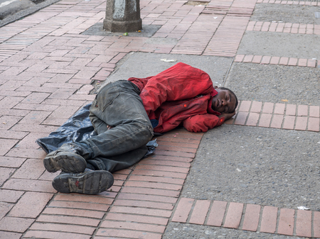 Bogota, Colombia - May 01, 2016: A homeless man sleeping on the street Bogota
