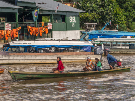 comely: Tabatinga, Brazil - May 05, 2016: A Huge traffic of different types of boats in the port of Amazon river