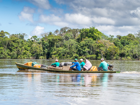 samll: Amazon River, Brazil: - May 07, 2016: Small boat with locals on the Amazon River