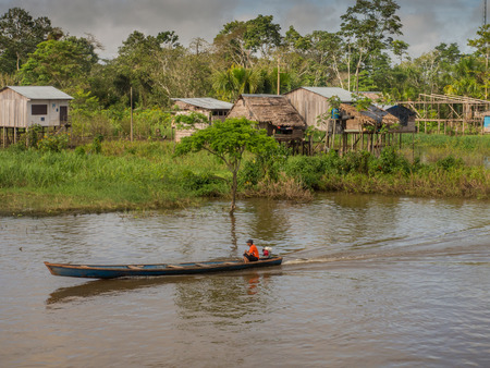 samll: Amazon River, Peru - May 12, 2016: Small village on the bank of the Amazon River