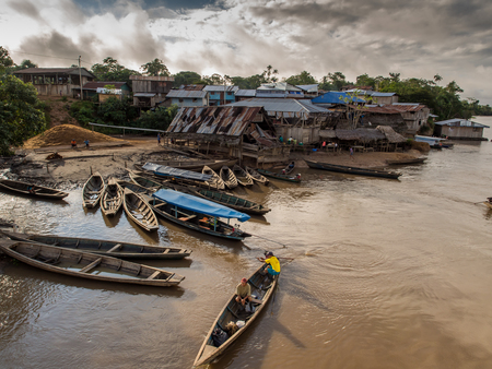 Amazon River, Peru - May 13, 2016: Traditional, indian  boats  on the bank of the river