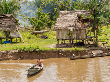 Amazon River, Peru - May 13, 2016:  Small village on the bank of the Amazon River