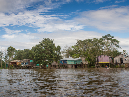 Amazon River, Peru - May 11, 2016:  Small village on the bank of the Amazon River