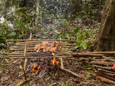 Lagoon of Jaguar, Brazil - May 7, 2016: Preparing meal in the Amazons jungle Editorial