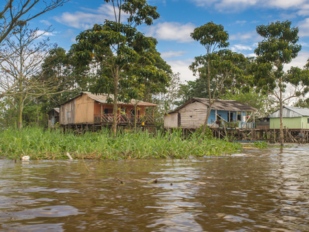 samll: Amazon River, Peru - May 11, 2016:  Small village on the bank of the Amazon River