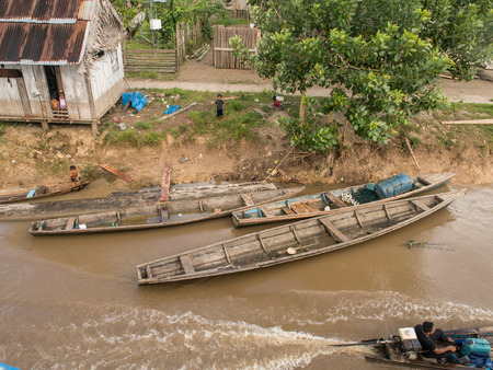 birchbark: Amazon River, Peru - May 12, 2016: Traditional, indian  boats  on the bank of the river