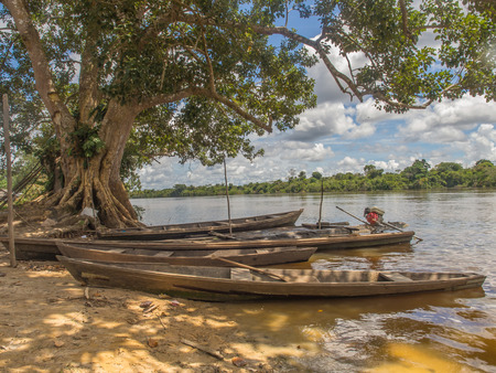 comely: Santa Rita, Peru - May 9, 2016: Traditional, indian  boats  on the bank of the river Editorial