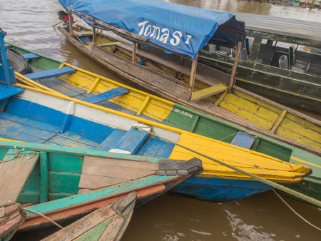 birchbark: Santa Rosa, Peru - May 11, 2016: Traditional, indian  boats  on the bank of the river Editorial