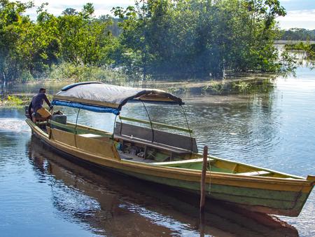 birchbark: Palmari, Brazil - May 6, 2016: Wooden  boat  on the Javari river Editorial