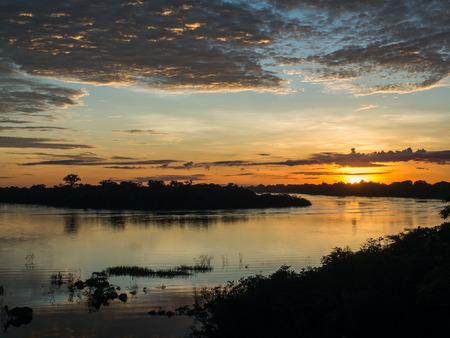 amazonia: Palmari, Brazil - May 06, 2016: Sunrise over the Javari river in  Amazonia. Editorial
