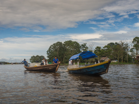 Amazon River, Peru: - May 11, 2016: Small boat with locals on the Amazon River