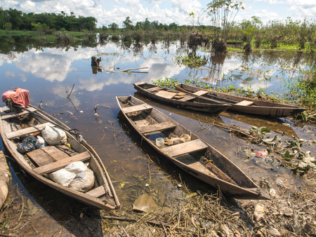 Santo Tomas, Peru  - May 17, 2016: Traditional, indian  boats  on the bank of the river Editorial