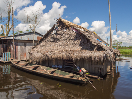 shantytown: Iquitos, Peru- May 16, 2016: Floating houses in a small city in  Peru.
