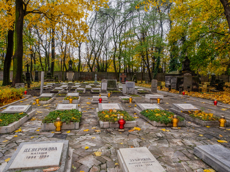 tumulus: Warsaw, Poland - October 31, 2016: Graves of the Russian builders of the Palace of Culture and Science