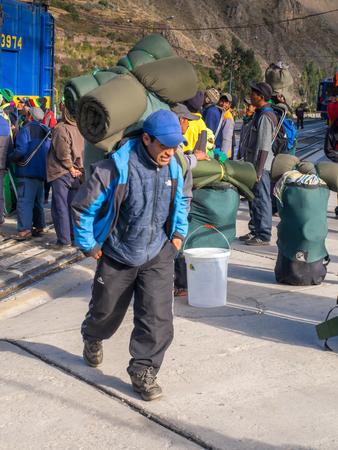 heaviness: Ollantaytambo, Peru - May 13, 2016: Local people deboarding the PeruRail train at Ollantaytambo station.