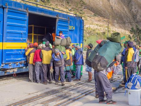 tramcar: Ollantaytambo, Peru - May 13, 2016: Local people deboarding the PeruRail train at Ollantaytambo station.