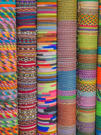 wristlets: Colorful bracelets  from natural materials on the stalls i Cusco. Stock Photo