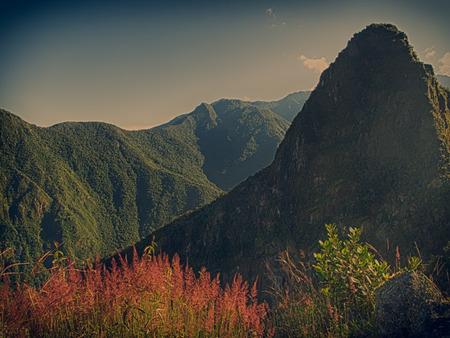 Machu Picchu, Peru - May 22, 2016:  Mountains over the Incan ruins,