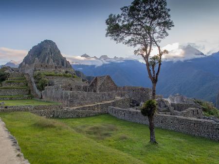 Machu Picchu, Peru - May 22, 2016:  View of Machu Picchu showing the ancient Incan site with Wayna Picchu  Huayna Picchu behind.