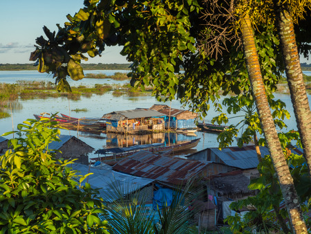 submersion: Houses on the flood plain of the Amazon river.  Iquitos, Peru