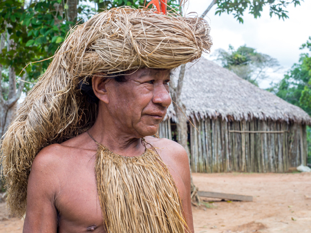 headman: Iquitos, Peru- May 15, 2016: Yagua Senior Indian in his local costume