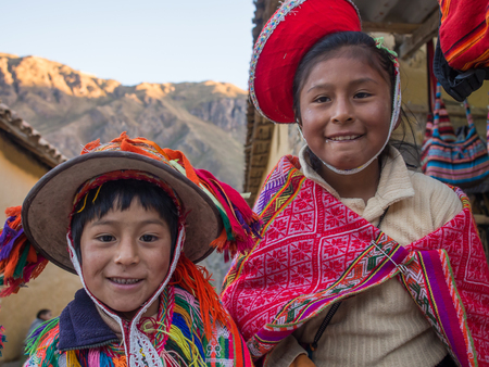 Ollantaytambo, Peru - May 20, 2016: Kids in colorful, folk costumes in the Pisac market