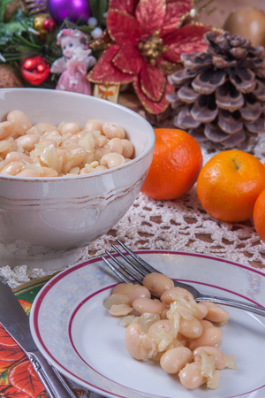 haricot: White beans with garlic -  traditional Polish Christmas Eve dishes on the table